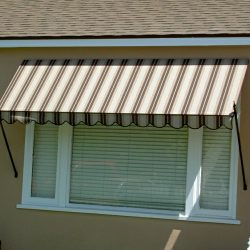 Window spearhead awning with striped awning fabric