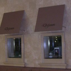 Window awnings with black awning graphics for Dejaun