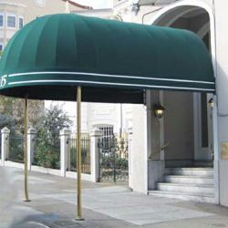 Green entrance awning for an apartment complex