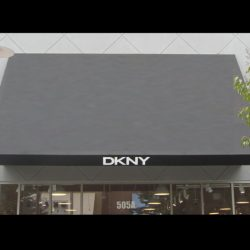 Black storefront awning with custom awning graphics for DKNY