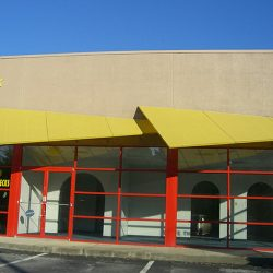 Custom commercial awning design with yellow awning fabric