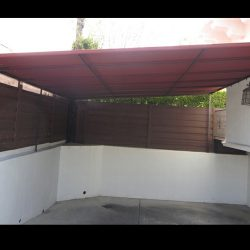 Residential carport awning with red awning fabric