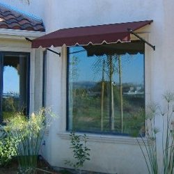 Custom window spearhead awning with dark red awning fabric