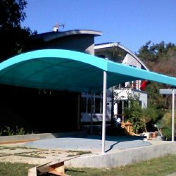 Custom residential awning with light blue awning fabric