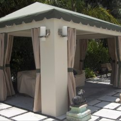 Small custom cabana with light awning fabric