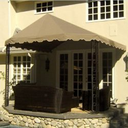 Sandy colored awning fabric on a residential patio shade awning