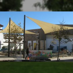 Tan commercial sun shade panels for a playground