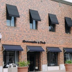 Black and navy blue commercial window awnings for Abercrombie & Fitch