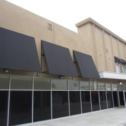Black window awnings and commercial awnings for Loft