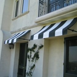 Striped white and green residential awnings