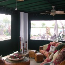 Green awning fabric on a residential drop-roll awning
