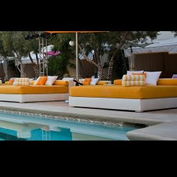 Orange and white pad cushions for a pool area