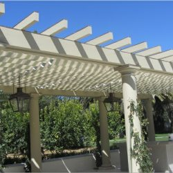 Dark custom trellis cover for a garden area