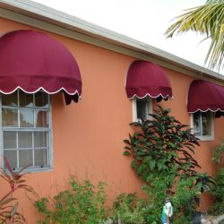 Residential dome awnings with red and white awning fabric
