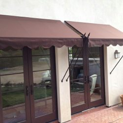 Entry way spearhead awning with maroon awning fabric
