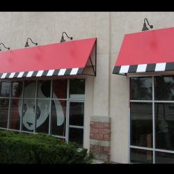 Custom red window awnings with checkered awning graphics for Panda Express