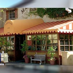 Orange and white striped storefront awning for Marmalade Cafe