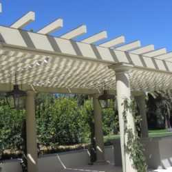 Custom trellis cover with white slide on wire awning fabric