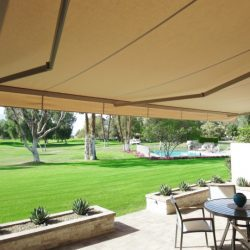 Dark tan awning fabric on a custom retractable awning