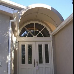 Custom residential awning with beige awning fabric