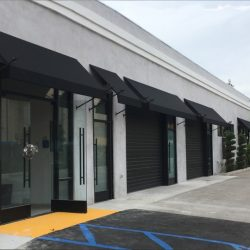Commercial window awnings with spearhead awning poles