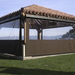 Cabana with brown drop-roll awning