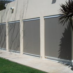 Dark grey drop-roll awning covers