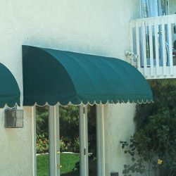 Green awning fabric on a residential porch awning