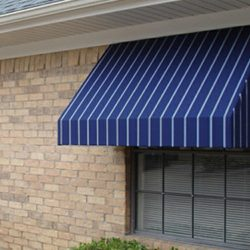 Striped white and blue awning fabric on a residential window awning