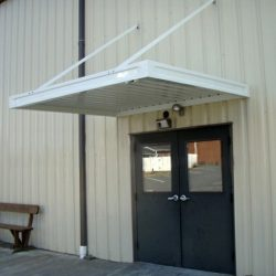 White aluminum awning over a door