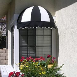 Black and white awning fabric on a residential dome window awning
