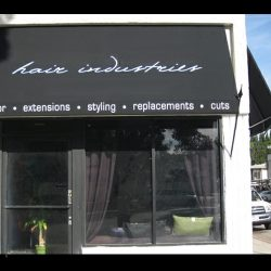 Hair Industries commercial spearhead awning with black awning fabric