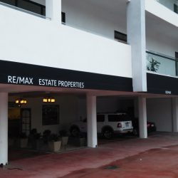 Black commercial awning for RE/MAX Estate Properties