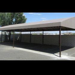 Grey awning fabric on a custom carport awning