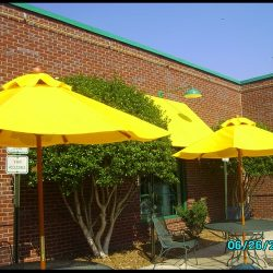 Yellow commercial shade umbrellas and yellow window awnings