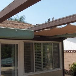Residential slide on wire awning with green and gold awning fabric