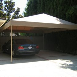 Custom residential carport awning with tan awning fabric