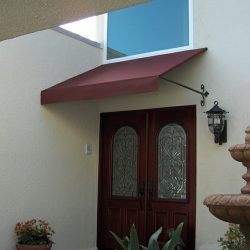 Maroon awning fabric on a residential entrance awning