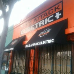 Black commercial awnings for Bike Attack Electric