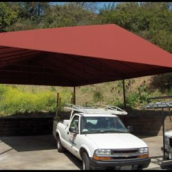 Carport awning with rust red awning fabric