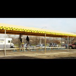 Yellow and black polka dot awning fabric on a custom carport awning