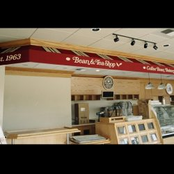 White awning graphics on a custom awning for The Coffee Bean