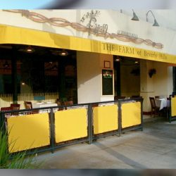 Custom yellow storefront awning for The Farm of Beverly Hills
