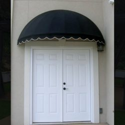 Residential dome awning with black and white awning fabric