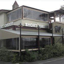 Custom tan storefront awning for Short Order