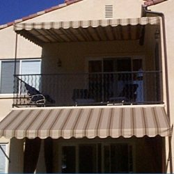 Residential patio shade awnings with striped awning fabric