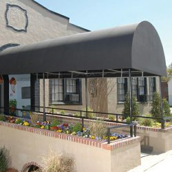Commercial entrance awning with grey awning fabric