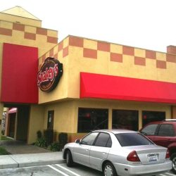 Custom commercial awnings for Shakey's with red awning fabric