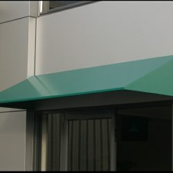 Residential metal awning colored green