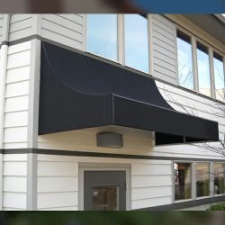 Black awning fabric on residential entrance awning